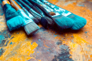 Artist-Paint-brushes-on-canvas